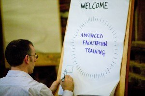 Posters, such as this 'Welcome', are one option we train for gathering and focusing meetings.